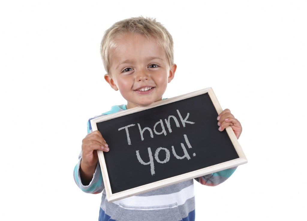 Boy and thank-you sign