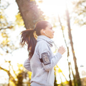 Sporty young woman running outside.