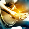 Guitarist on stage for background, vibrant soft and motion blur