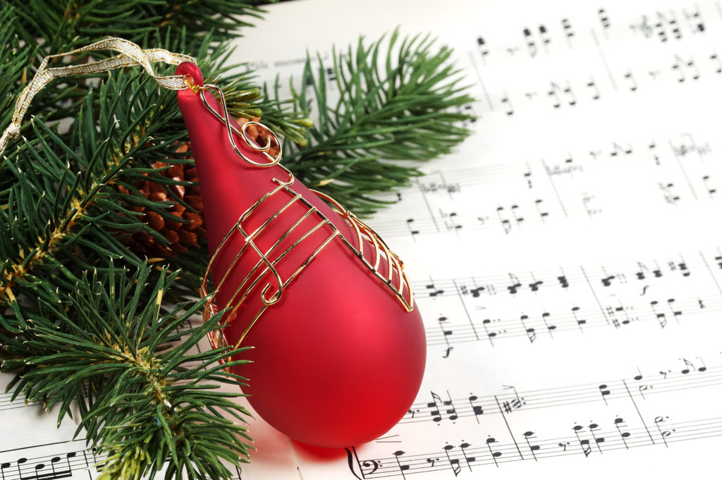 A piano piece of Christmas music with a bauble