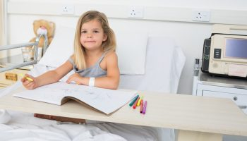 Portrait of little sick girl coloring book