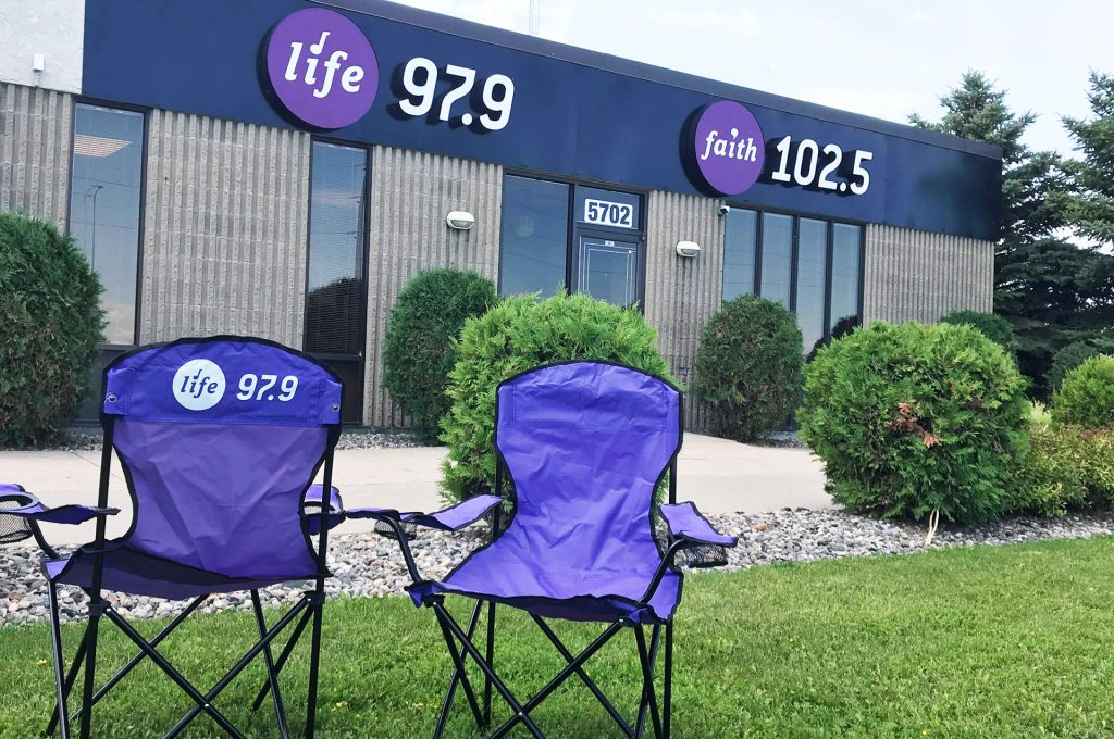 Life 97.9 Chairs in front of studio building